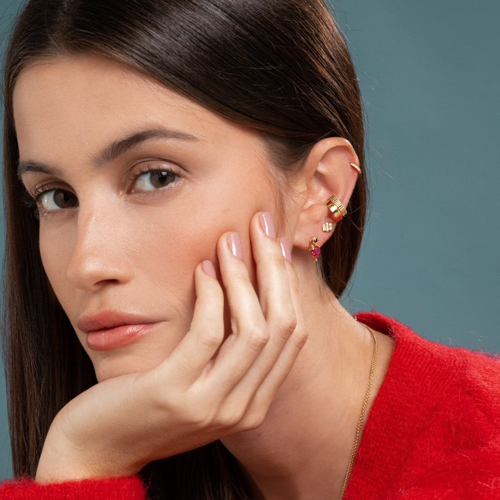 Lilian wearing the Yellow Gold Diamond Huggy Small, the Carved Gold Ear Cuff, the Gold Ear Cuff, the Triple Diamond Bar Studs and the Ruby Stud & Bright Pink Tourmaline Earring Pendant by McFarlane Fine Jewellery