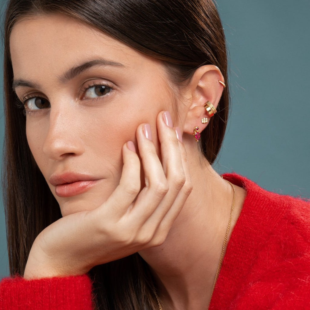 Lilian wearing the Ruby Stud with the Bright Pink Tourmaline Earring Pendant, the Triple Diamond Bar Studs, the Gold and Carved Ear Cuffs and the Yellow Gold Diamond Huggy Small by McFarlane Fine Jewellery