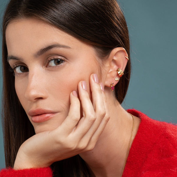 Lilian wearing the Yellow Gold Diamond Huggy Small, the Carved Gold Ear Cuff, the Gold Ear Cuff, the Triple Diamond Bar Studs and the Ruby Stud and Bright Pink Tourmaline Earring Pendant by McFarlane Fine Jewellery