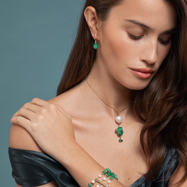 Lilian wearing the Drop Emerald Earrings, Emerald and Pearl Bracelet and the Emerald and Baroque Pearl Necklace by McFarlane Fine Jewellery