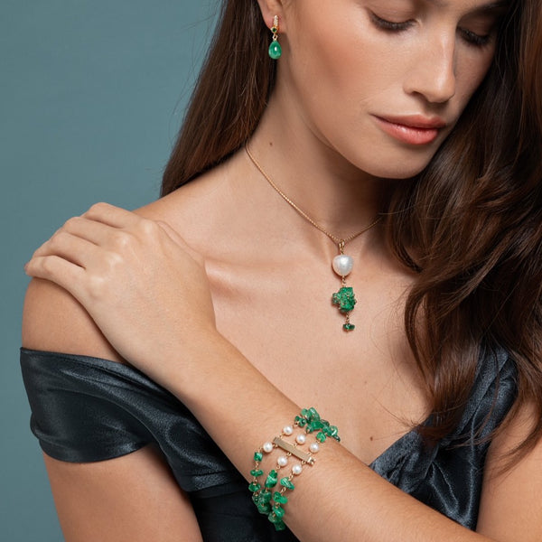 Lilian wearing the Emerald and Baroque Pearl Necklace, Emerald and Pearl Bracelet, Drop Emerald Earrings by McFarlane Fine Jewellery