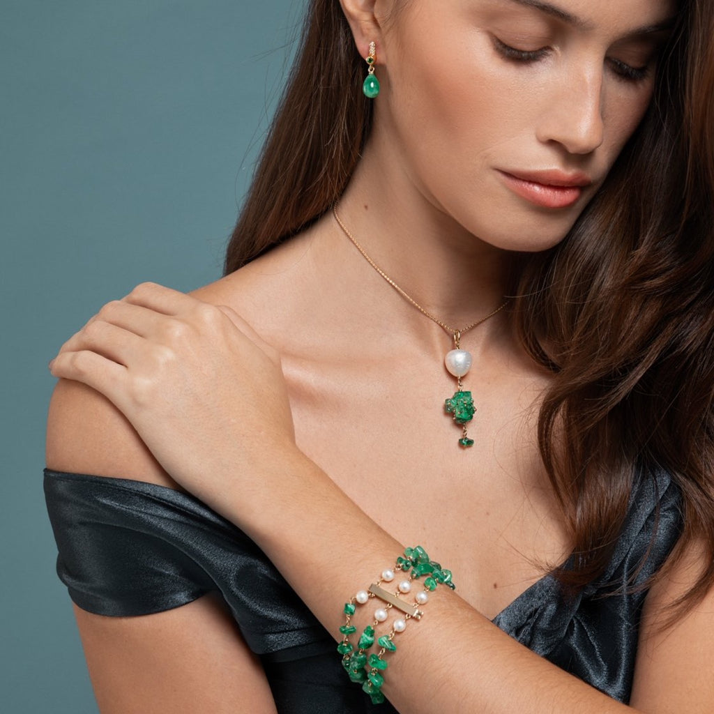 Lilian wearing the Emerald and Pearl Bracelet, Drop Emerald Earring and the Emerald and Baroque Pearl Necklace by McFarlane Fine Jewellery