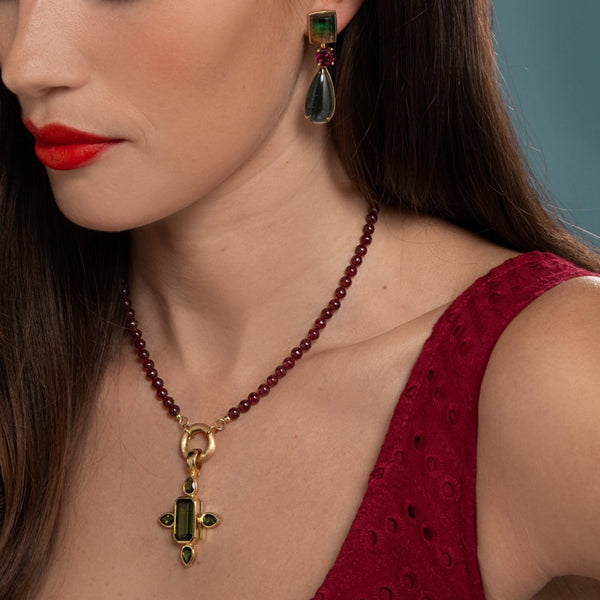 Lilian wearing the Ruby and Tourmaline Cross Necklace with the Tourmaline Earrings by McFarlane Fine Jewellery