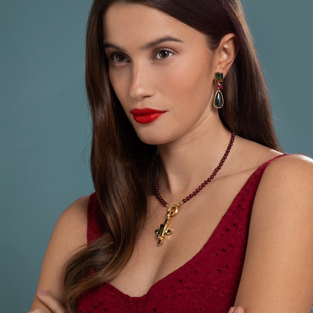 Lilian wearing the Ruby and Tourmaline Cross Necklace and Tourmaline Earrings by McFarlane Fine Jewellery