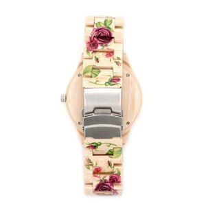 back of womens wood watch with roses on it