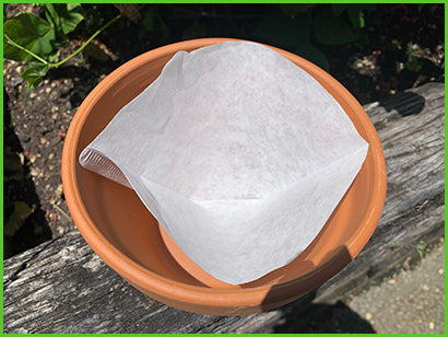 Keep soil inside your pots by inserting coffee filters