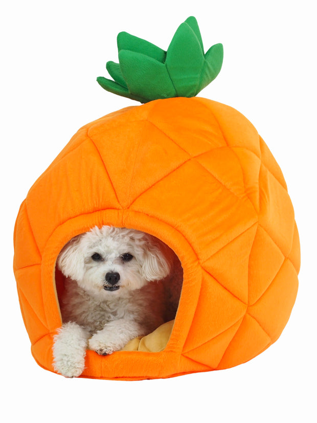 Pineapple shaped cave dog bed in bright orange