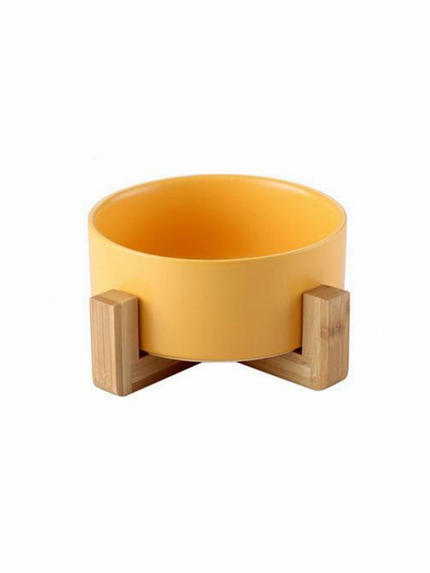 yellow ceramic and bamboo dog bowl
