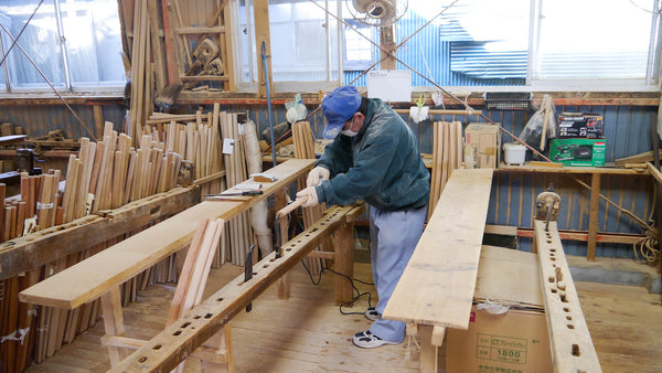 A craftsman at Horinouchi's workshop