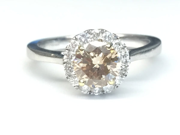 18 CARAT WHITE GOLD HALO RING WITH COGNAC CENTRE