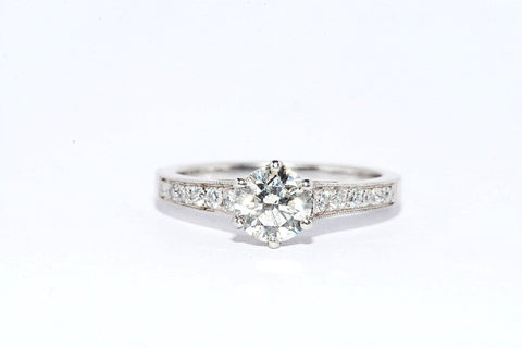 18 CARAT WHITE GOLD PAVE SET SHOULDERED DIAMOND RING
