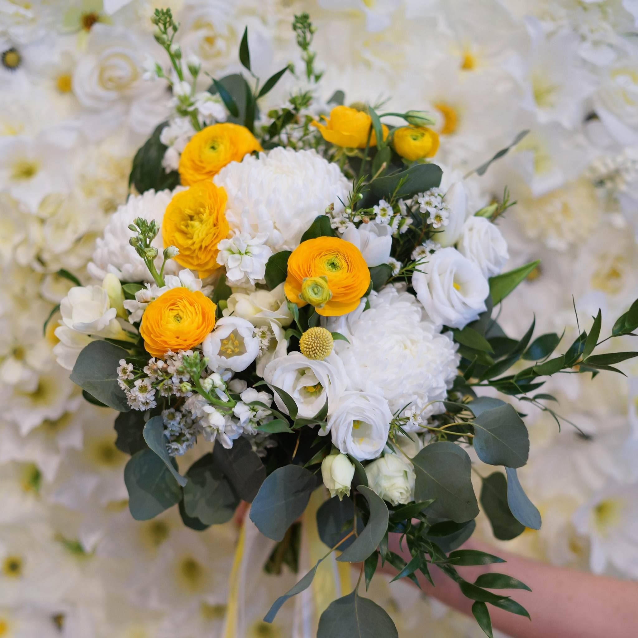 Bridal bouquet with commercial mums and ranunculus