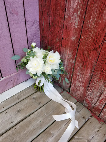 red barn at fields on westlake with a white peony bouquet and long ribbons- sage flowers