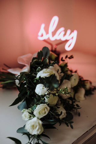 wedding bouquet with a neon 'slay' sign- sage flowers and niche photography kingston