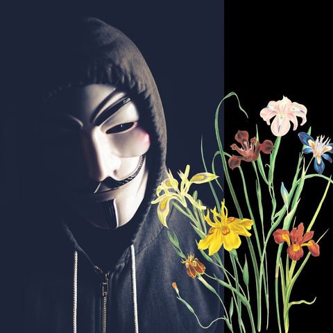person in anonymous mask holding a bunch of flowers