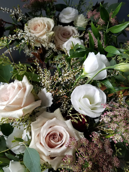 a moody wedding flower palette of quicksand roses and lisianthus, with chocolate queen anne's lace