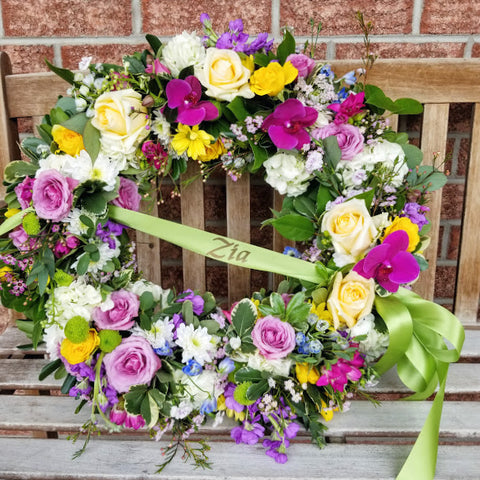 colourful sympathy wreath for kingston ontario funeral yellow purple and green