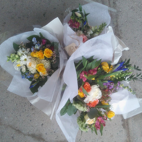 multicoloured bouquets wrapped in tissue