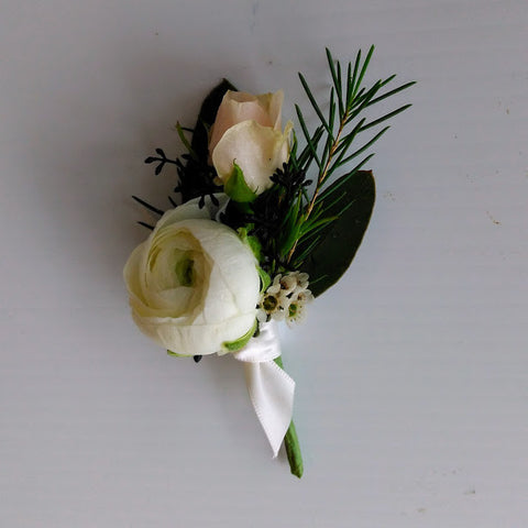 blush and white ranunculus and rose boutonnniere