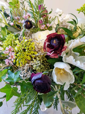 flowers in burgundy and green, with grey moss and dusty miller
