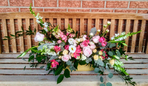 large pink funeral flower arrangement sent to tompkins funeral home in kingston on