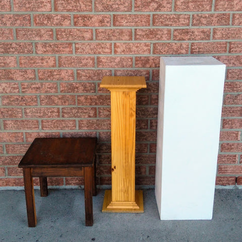 rustic stool, classic podium, and white square pedestals for rent at sage flowers