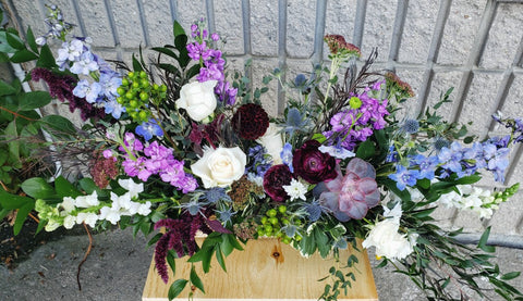 sympathy flowers in garden style with ranunculus, dahlia and delphinium