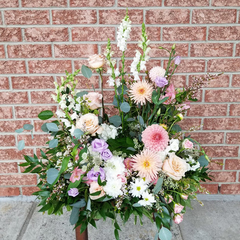 pink wild garden style flower arrangement for a funeral urn- florist Sage Flowers for sympathy in Kingston Ontario