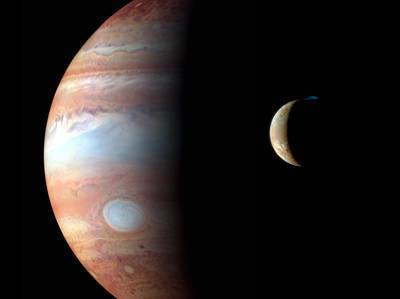 Jupiter and it's moon Io from New Horizons - Image Credit NASA