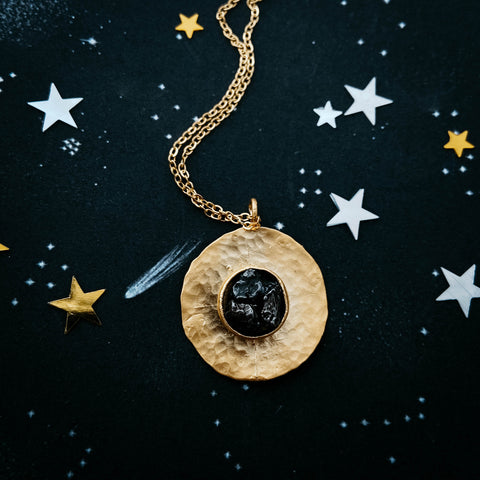 Authentic meteorite jewelry set giveaway on Yugen Tribe blog - round gold necklace with chunk of meteor