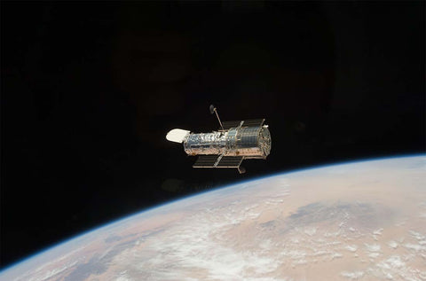 Hubble Telescope above planet Earth - Image Credit NASA