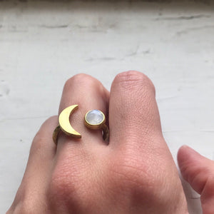 Gold crescent moon ring with rainbow moonstone - handmade jewelry by yugentribe - on white female hand