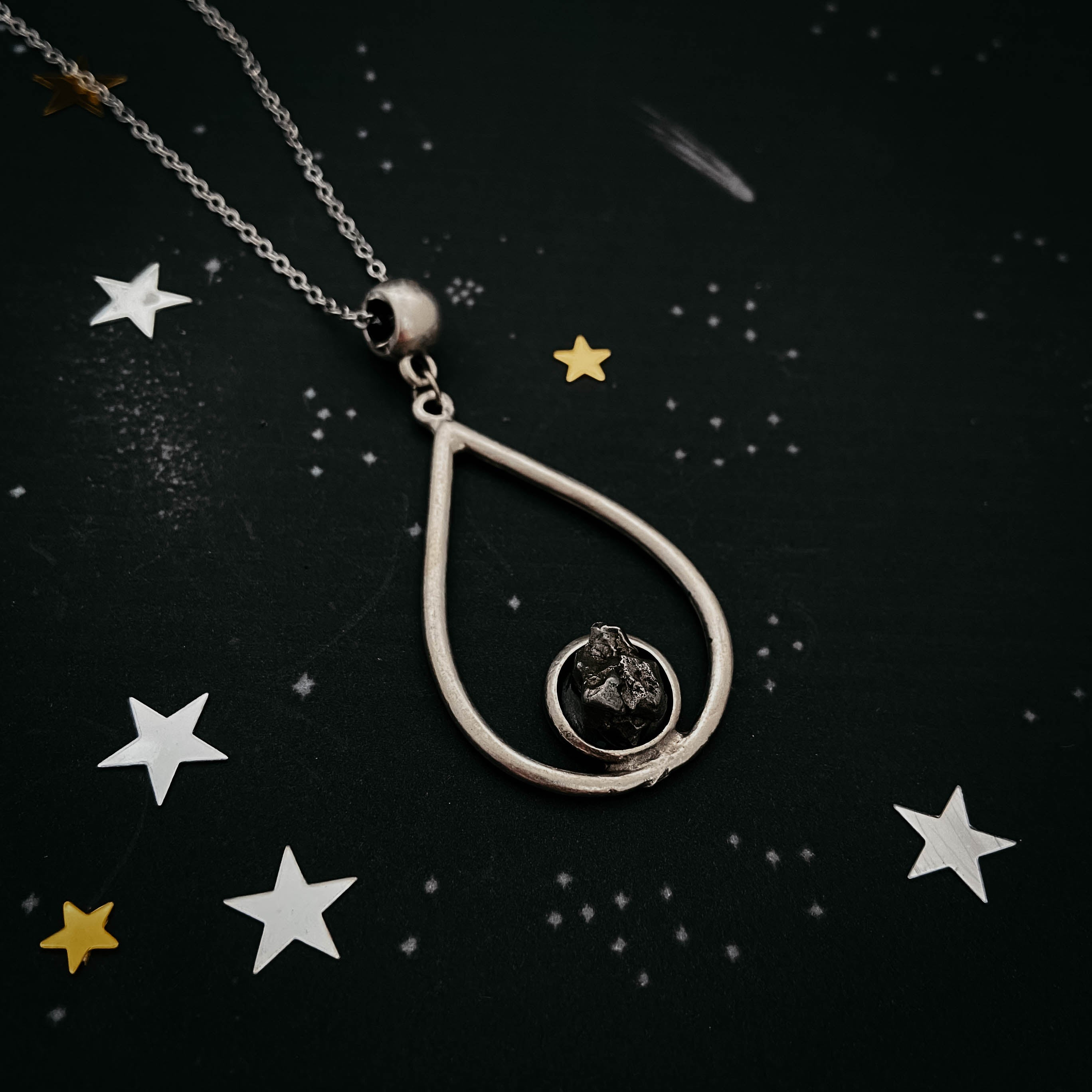 Teardrop shaped pendant necklace set with authentic campo del cielo meteorite - Handcrafted by Yugen