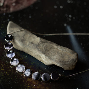 Curved moon phase necklace with 9 different lunar phases - Outer space new age luna jewellery - STEM fashion by Yugen Tribe