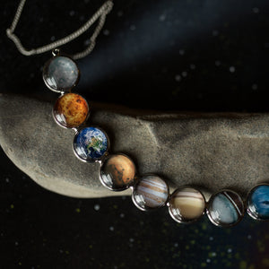 Curved Solar System Necklace in Silver with 9 Planets - Statement Bib Pendant, handmade STEM astronomy fashion by Yugen Tribe
