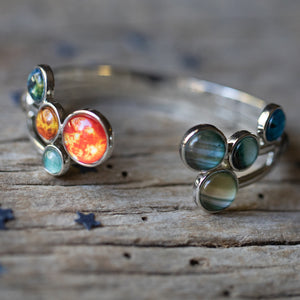 Solar system cuff bracelet by Yugen Tribe - Silver adjustable bracelet with all 9 planets and the Sun - Featured in UncommonGoods - Handmade Outer Space Galaxy Jewelry by Lauren Beacham