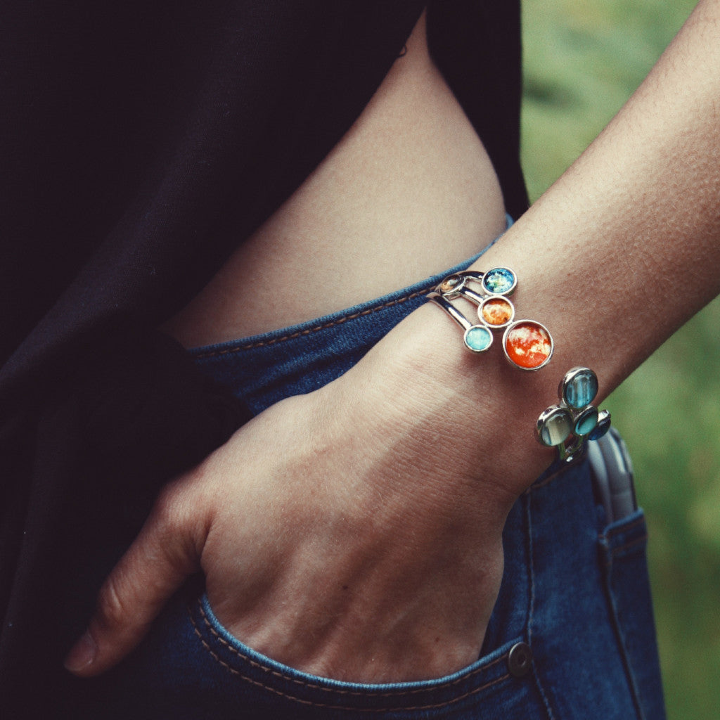 Solar system cuff bracelet by Yugen Tribe - Silver adjustable bracelet with all 9 planets and the Sun - Featured in UncommonGoods