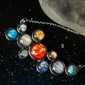 Colorful Solar System Necklace - Silver statement pendant including the sun, Mercury, Venus, Earth, Mars, Jupiter, Saturn, Uranus, Neptune, and Pluto - Handmade galaxy jewelry by Yugen Tribe inspired by the cosmos and the universe