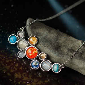 Solar System Necklace - Silver statement pendant including the sun, Mercury, Venus, Earth, Mars, Jupiter, Saturn, Uranus, Neptune, and Pluto - Handmade galaxy jewelry by Yugen Tribe inspired by the cosmos and the universe