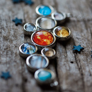 Close Up Solar System Necklace - Silver statement pendant including the sun, Mercury, Venus, Earth, Mars, Jupiter, Saturn, Uranus, Neptune, and Pluto - Handmade galaxy jewelry by Yugen Tribe inspired by the cosmos and the universe