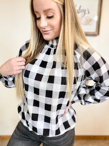 Black and white plaid top with elastic neck, cuffs, and waist - Wesley's