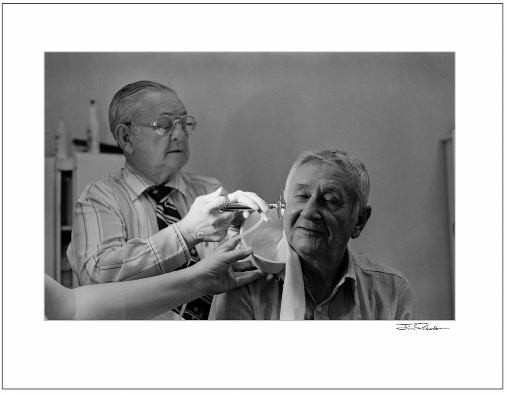 Doc Cleaning out the Ear Wax, Cuba, Kansas