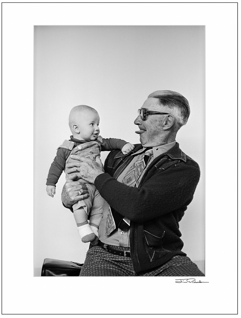 Emil Makalous entertaining a Baby, Cuba, Kansas