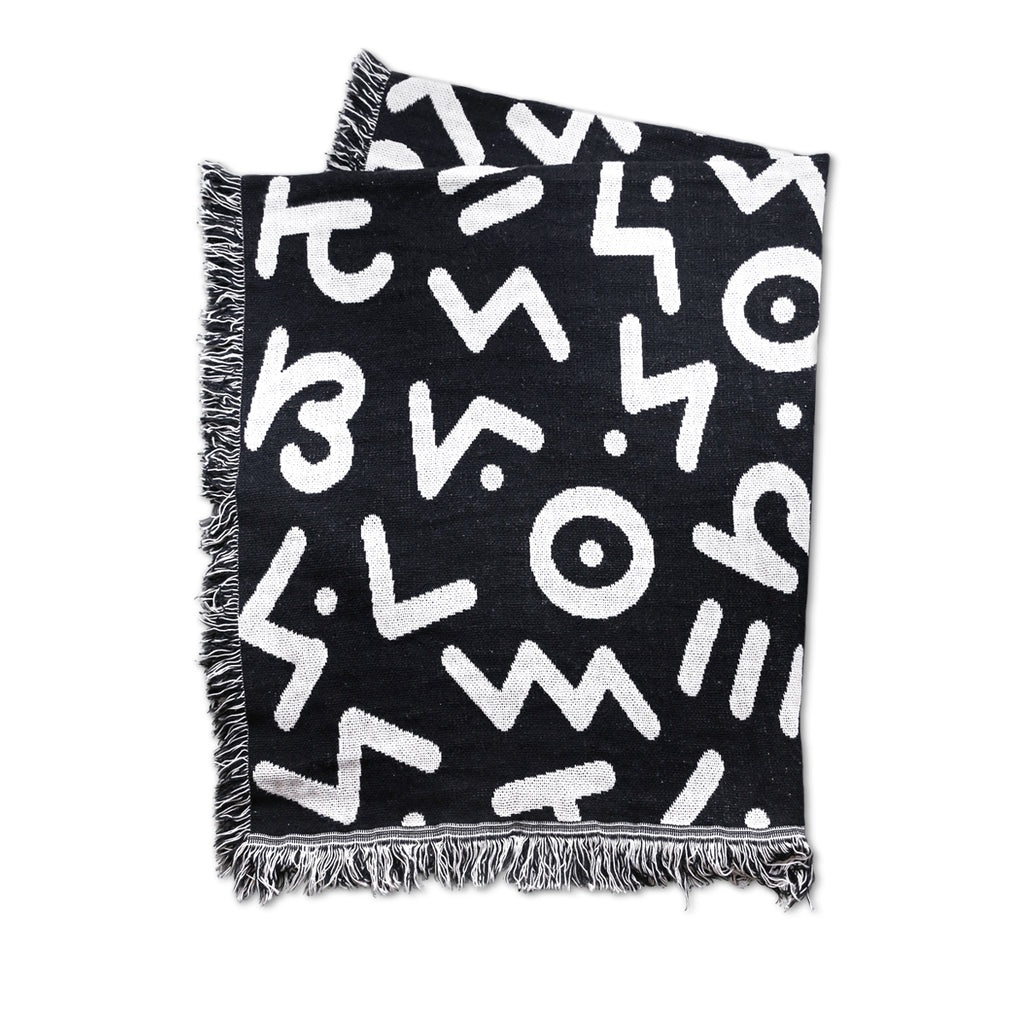 "BRYAN ESPIRITU: SIGNATURE TYPE PATTERN THROW BLANKET - BLACK / SCOUR [48x60""]"
