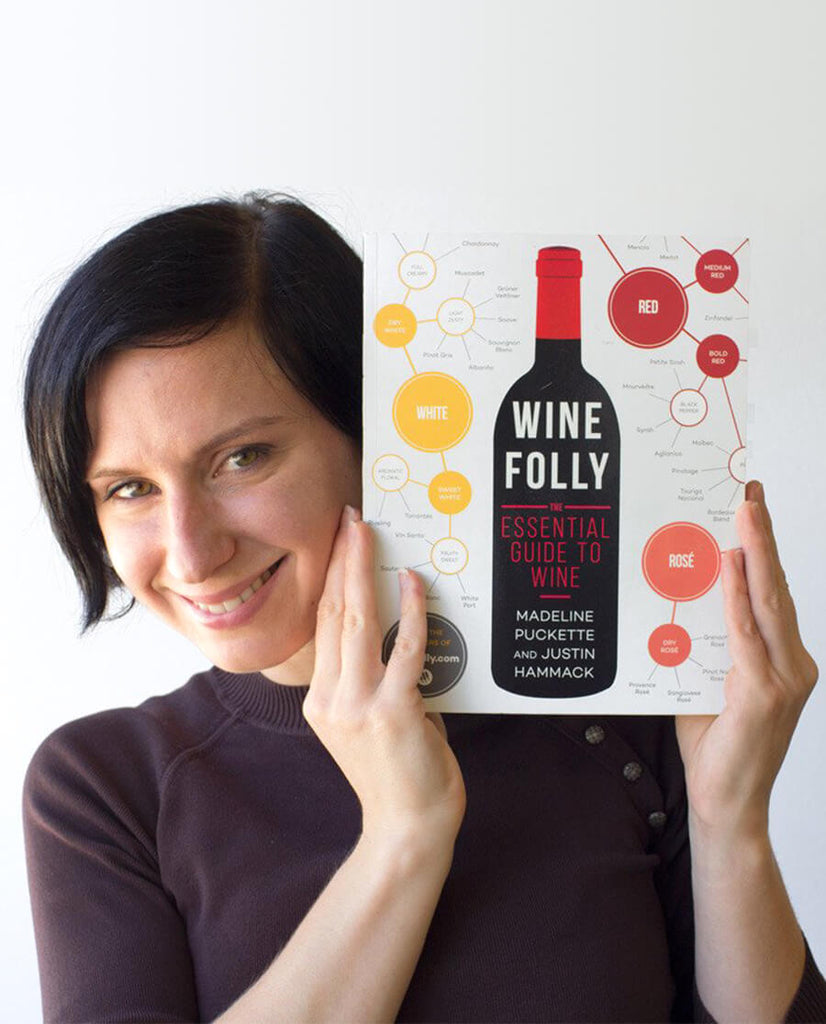 Madeline Puckette holds a copy of her first book: Wine Folly: The Essential Guide to Wine in 2015