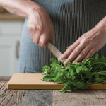 Undercut Series Cutting Board and herbs being chopped - bambu