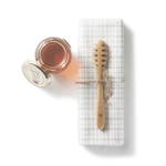 Organic Bamboo Honey Dipper on napkin