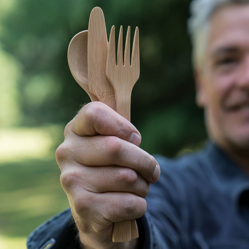 Bamboo Cutlery Set: Spoon, Knife & Fork held in hand