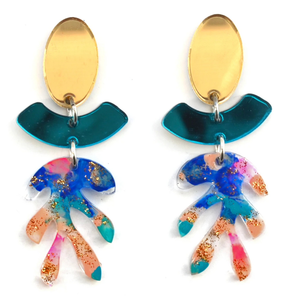 Boo and Boo Factory abstract art blue and gold glitter leaf earrings from Diament Jewelry, a gift shop in Washington, DC.