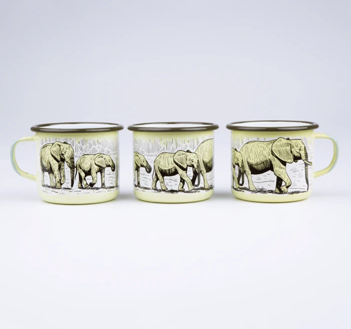 Emalco Yellow Elephant Mug from Diament Jewelry, a gift shop in Washington, DC.